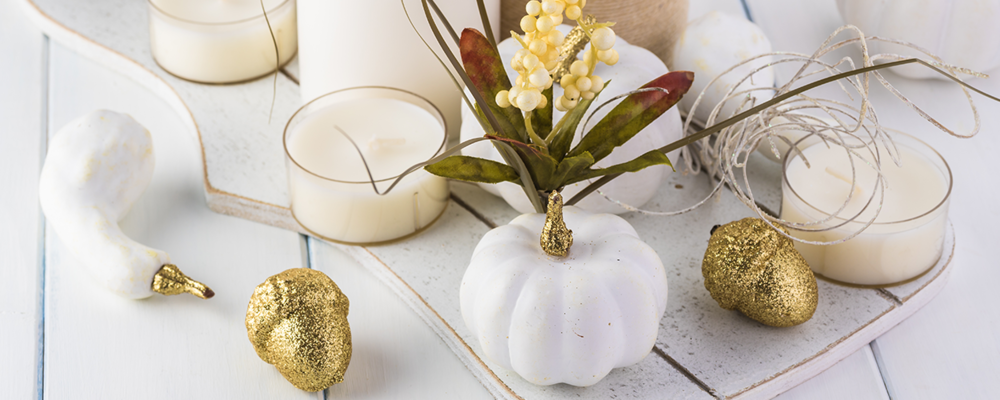 Modern fall decor trend with white and gold pumpkins