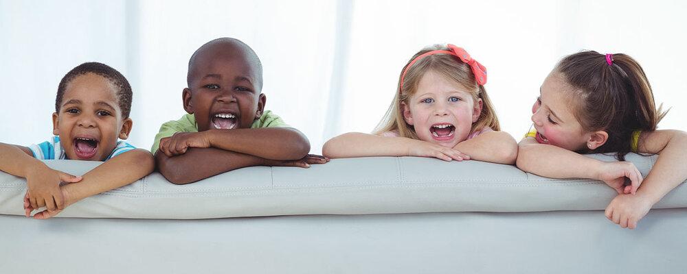 Kids Sitting on Kid-Friendly Fabric