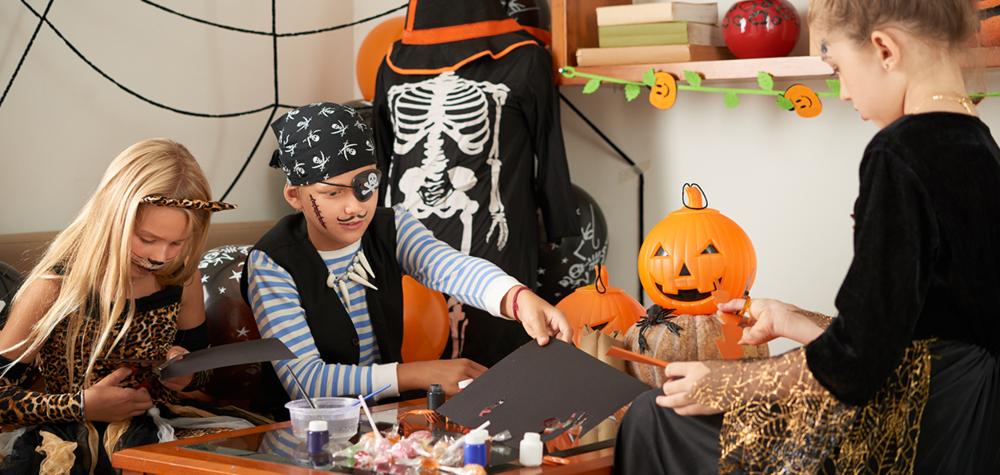 Kids creating DIY Halloween crafts