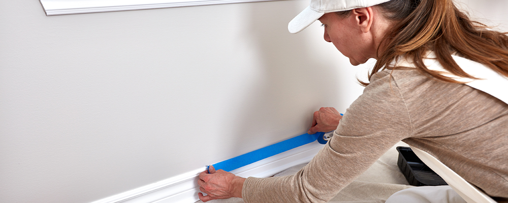 Woman applying painter's tape