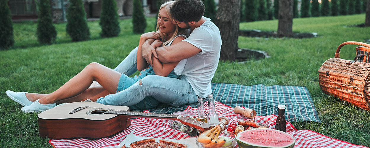 Couple enjoying backyard picnic for Valentine's Day at home