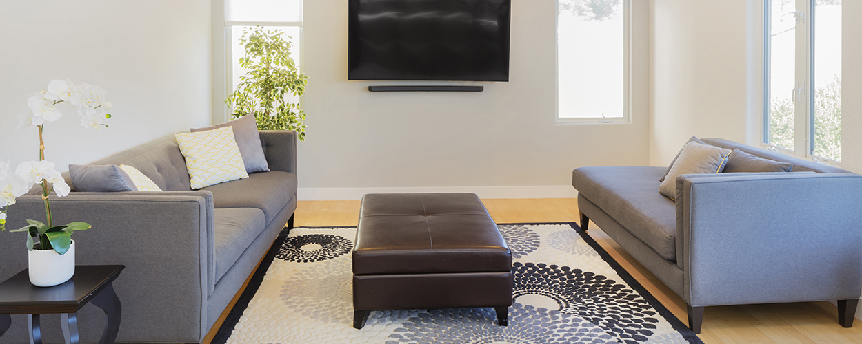 TV mounted on wall for small living room hack